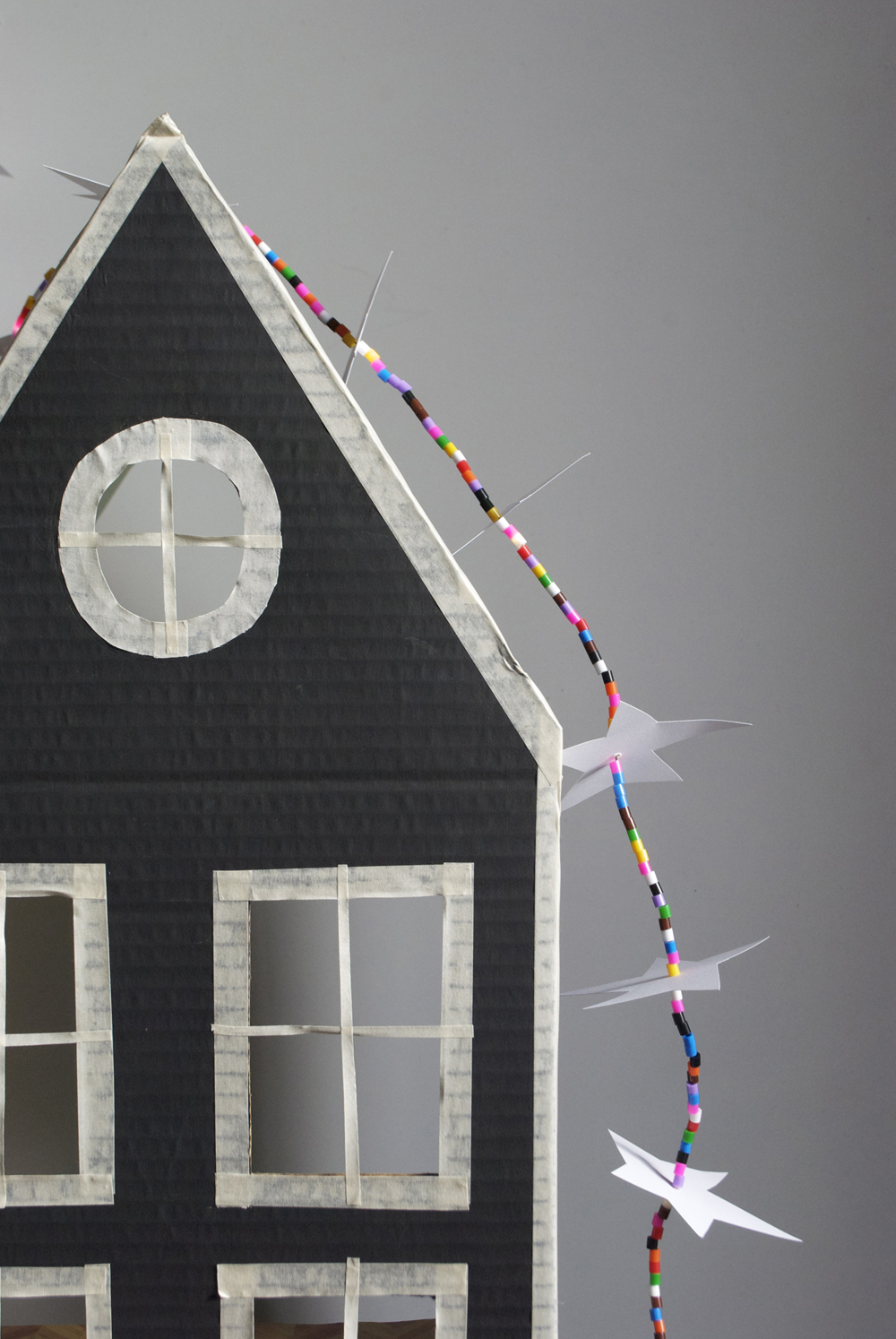 cardboard house with LED star strand